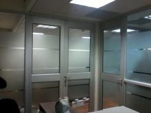 Sandblast applied in a computer generated and cut pattern as obscurity to glass office dividers