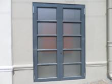 Sandblast vinyl, applied internally, as a neutral, upmarket, obscurity film to a Back of house door