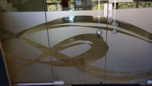 Sandblast vinyl logo, computer cut and applied to office entrance